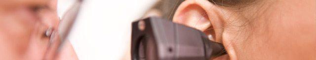 doctor-looking-at-ear-arrows