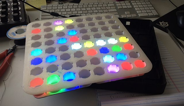 With the boards connected, the under-development Midi Fighter 64.
