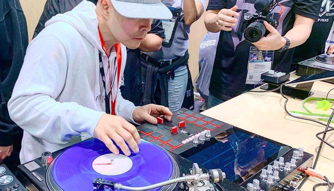 Qbert launching the Invader DJ mixer at NAMM 2019